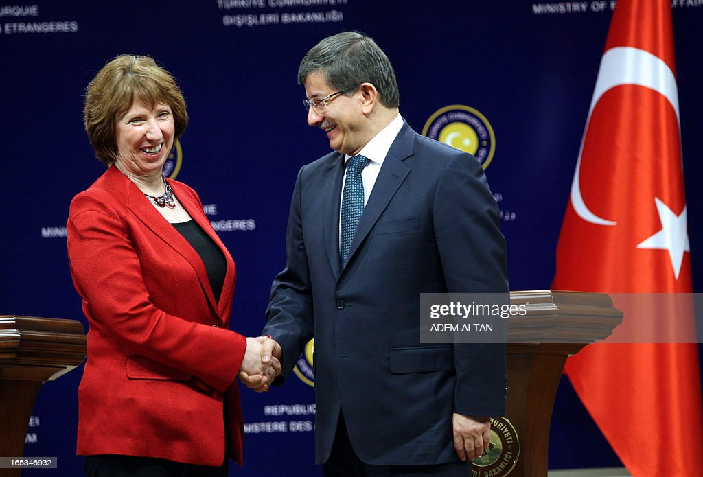 Catherine Ashton, the EU's foreign affairs chief, (L) shakes hands with Turkish Foreign Minister Ahmet Davutoglu during a press conference in Ankara, on April 3, 2013.