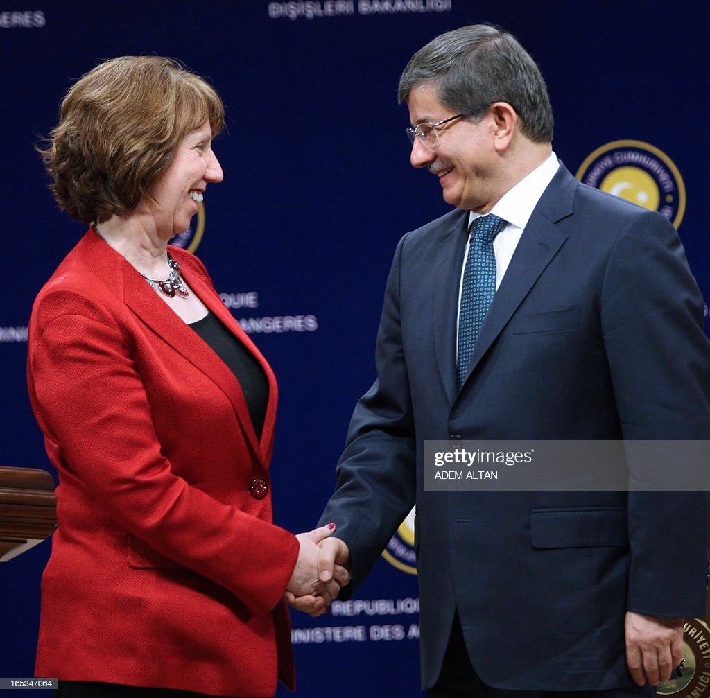 Catherine Ashton, the EU's foreign affairs chief shakes hands with Turkish Foreign Minister Ahmet Davutoglu during a press conference in Ankara, on April 3, 2013.