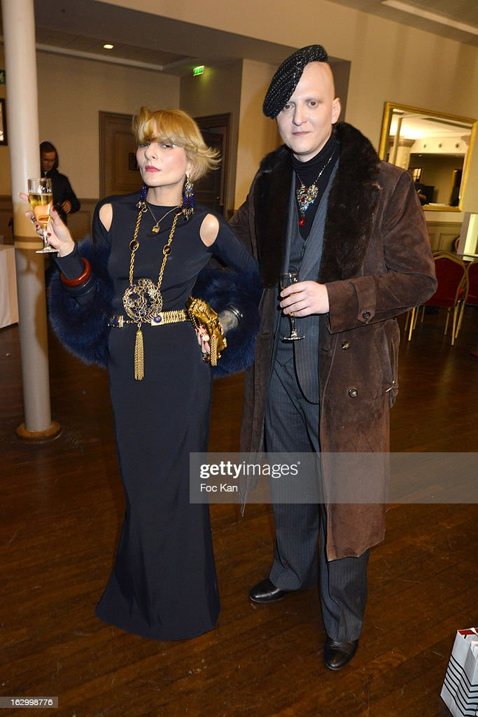 Catherine Baba (L) and Ali Mahdavi attend the Jean Paul Gaultier Fall/Winter 2013 Ready-to-Wear show as part of Paris Fashion Week at Sall Wagram on March 2, 2013 in Paris, France.