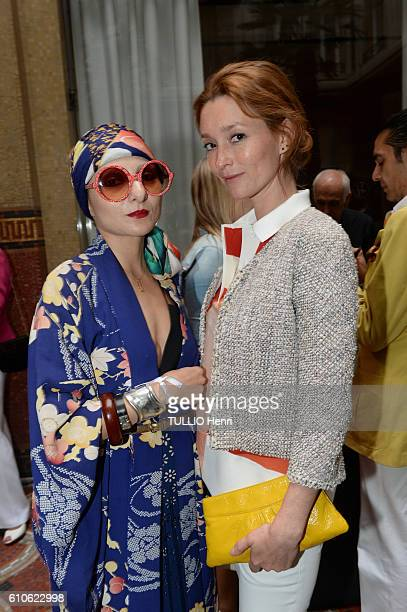 Catherine Baba and Audrey Marnay pose for Paris Match in the brazilian party at the Hotel Prince de Galles on june 29 2016 in Paris France