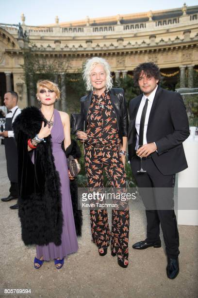 Catherine Baba Ellen Von Unwerth and German Larkin arrive for the amfAR Paris Dinner at Le Petit Palais on July 2 2017 in Paris France