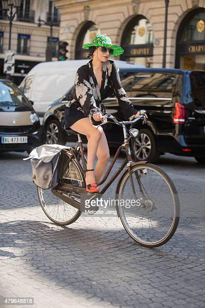 Catherine Baba exits the Schiaparelli show at Hotel d'evreux by bike on July 6 2015 in Paris France