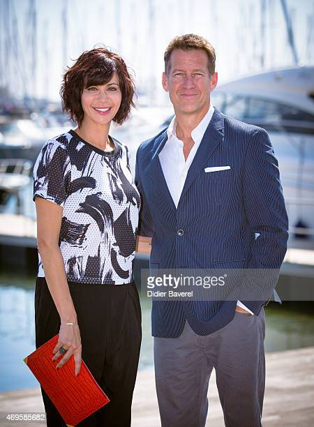 Catherine Bell and James Denton pose during the 'The Good Witch' photocall at MIPTV on April 13 2015 in Cannes France