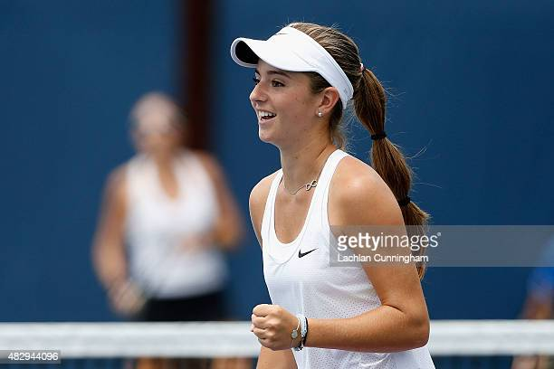 Catherine Bellis of the United States celebrates a point in her doubles match with Jacqueline Cako of the United States against Anabel Medina...