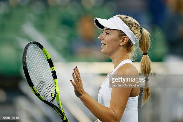 Catherine Bellis of the United States celebrates a win against Jelena Ostapenko of Latvia during day two of the Bank of the West Classic at the...