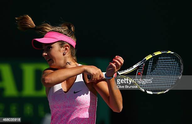 Catherine Bellis of the United States in action against Serena Williams of the United States in their third round match during the Miami Open...