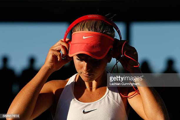 Catherine Bellis of the United States listens to music before her match against Venus Williams of the United States during day five of the Bank of...
