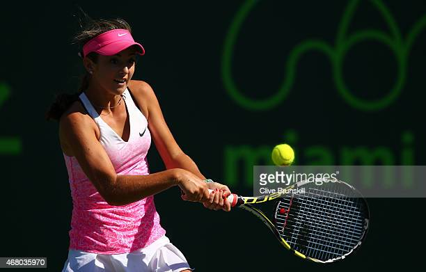 Catherine Bellis of the United States plays a backhand against Serena Williams of the United States in their third round match during the Miami Open...