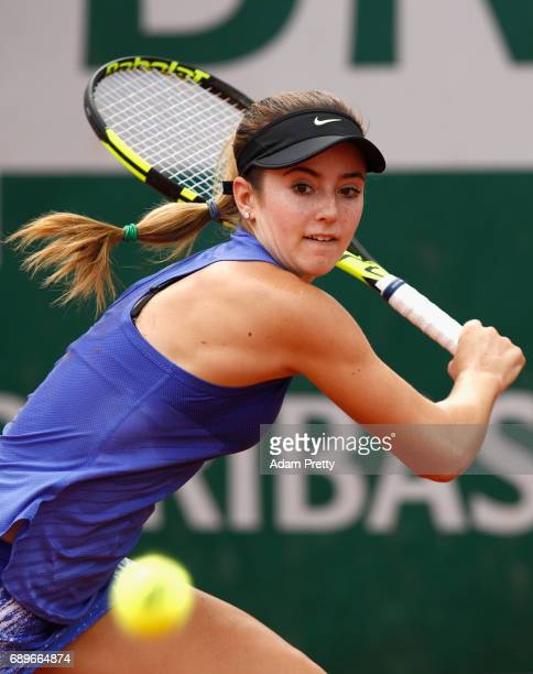 Catherine Bellis of The United States plays a backhand during the ladies singles first round match against Quirine Lemoine of The Netherlands on day...