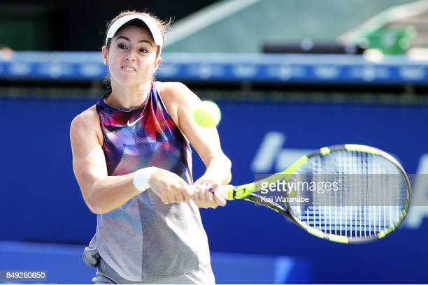 Catherine Bellis of the United States plays a backhand in her match against Anastasia Pavlyuchenkova of Russia during day two of the Toray Pan...