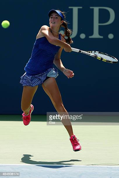 Catherine Bellis of the United States returns a shot to Natalia Vikhlyantseva of Russia during their junior girls' singles second round match on Day...