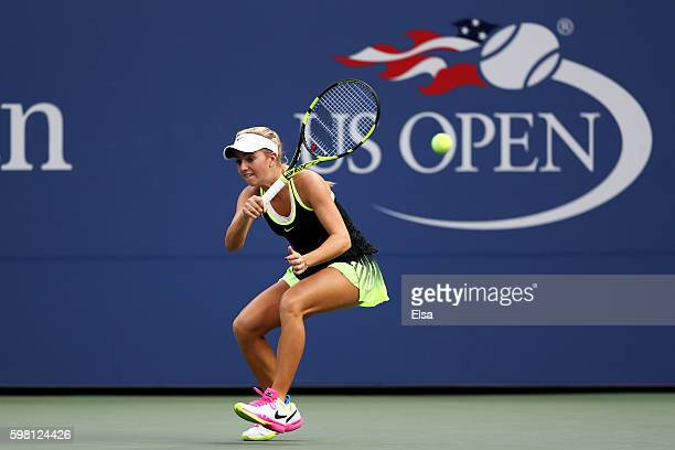 Catherine Bellis of the United States returns a shot to Shelby Rogers of the United States during her second round Women's Singles match on Day Three...
