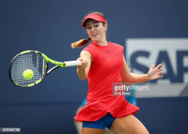 Catherine Bellis of the United States returns a shot to Veronica Cepede Royg of Paraguay during Day 4 of the Bank of the West Classic at Stanford...