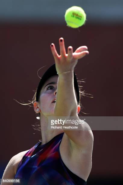 Catherine Bellis of the United States serves to Nao Hibino of Japan during their first round Women's Singles match on Day Three of the 2017 US Open...