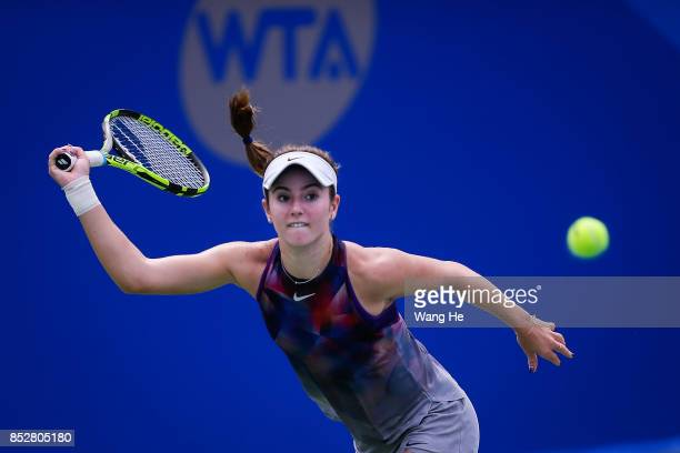 Catherine Bellis of USA returns a shot during the match against Ashleigh Barty Australia on Day 1 of 2017 Dongfeng Motor Wuhan Open at Optics Valley...