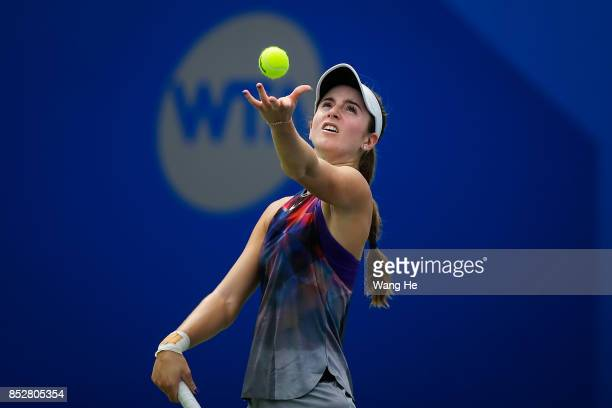 Catherine Bellis of USA serves against Ashleigh Barty of Australia during 2017 Dongfeng Motor Wuhan Open at Optics Valley International Tennis Center...