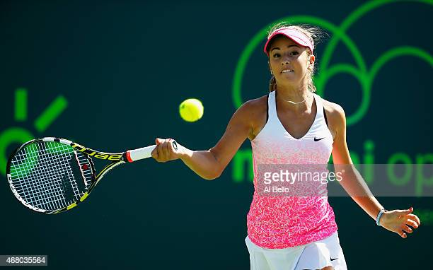 Catherine Bellis returns the ball against Serena Williams during day 7 of the Miami Open at Crandon Park Tennis Center on March 29 2015 in Key...