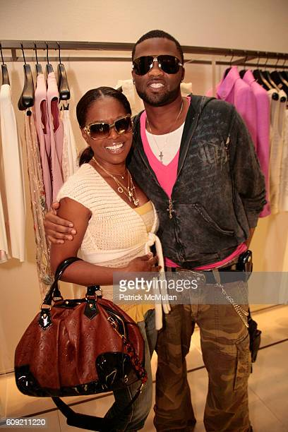 Catherine Brewton and Wardell Malloy attend Valentino and Holly Robinson Peete Rodney Peete host cocktail shopping event with wives of the NFL...