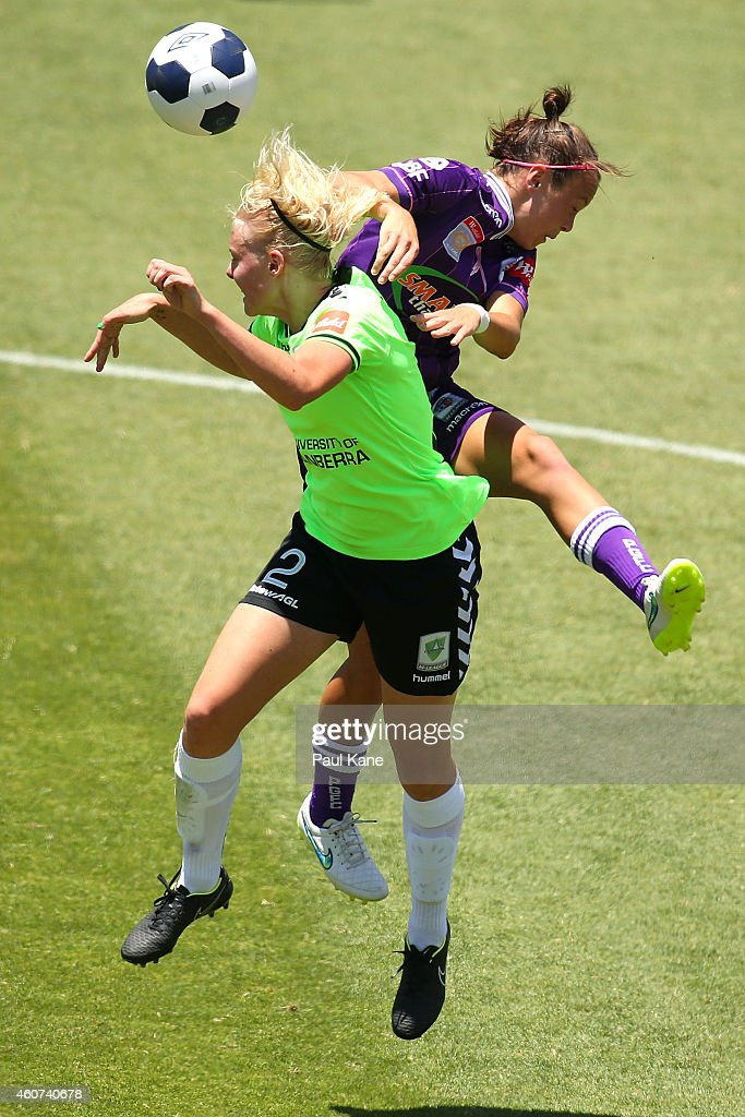 Catherine Brown of Canberra and Caitlin Foord of the Glory contest for the ball during the W-League Grand Final match between Perth and Canberra at nib Stadium on December 21, 2014 in Perth, Australia.