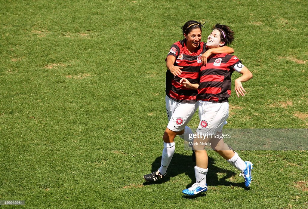 Catherine Cannuli and Sarah Walsh of the Wanderers celebrate a goal by Walsh during the round six W-League match between the Western Sydney Wanderers and the Newcastle Jets at Campbelltown Sports Stadium on November 25, 2012 in Sydney, Australia.