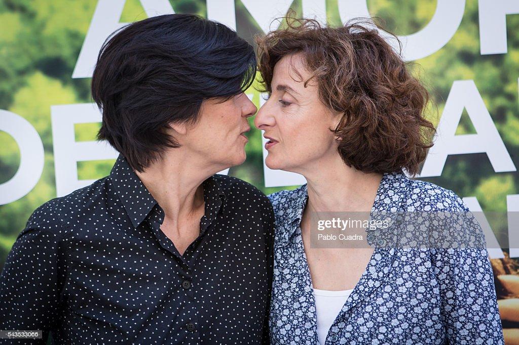 Catherine Corsini kisses Elisabeth Perez during a photocall to present 'La Belle Saison' (Un Amor de Verano) at Golem Cinema on June 29, 2016 in Madrid, Spain.