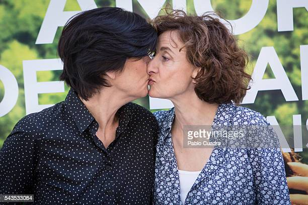 Catherine Corsini kisses Elisabeth Perez during a photocall to present 'La Belle Saison' at Golem Cinema on June 29 2016 in Madrid Spain