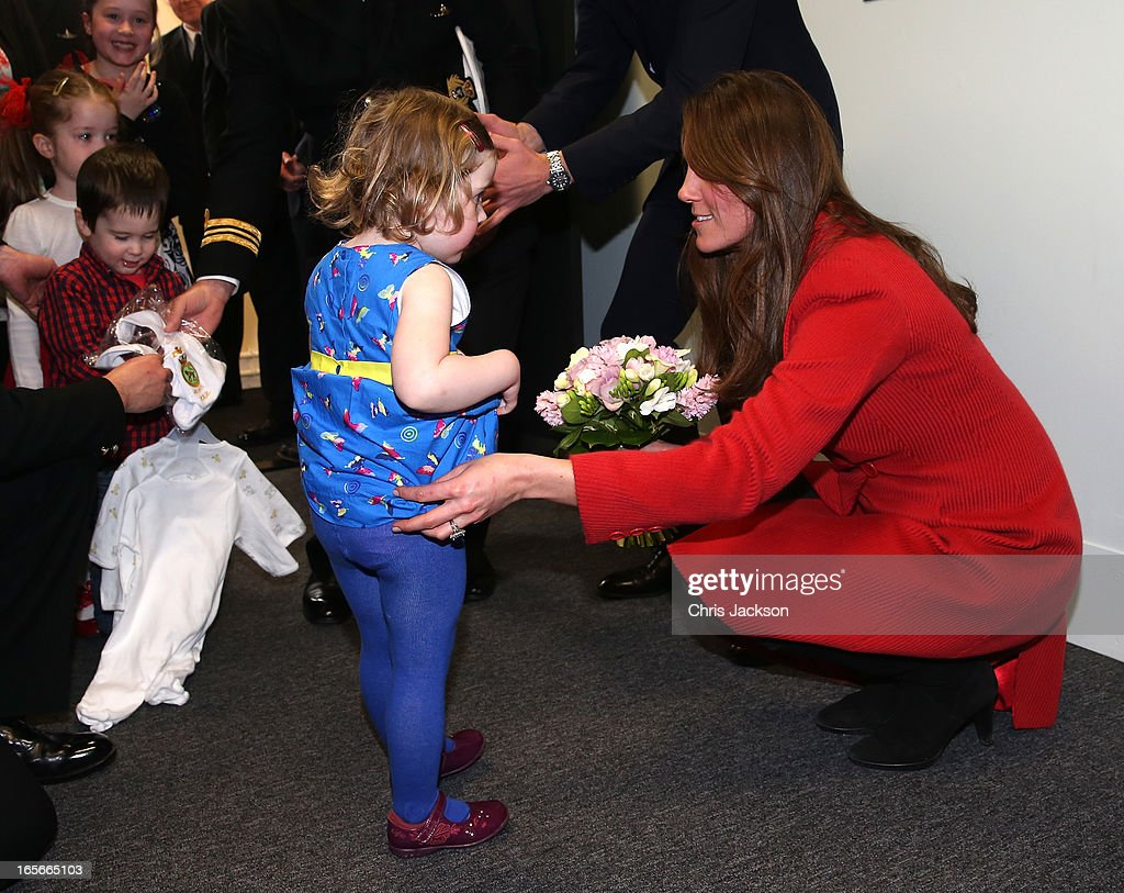 <a gi-track='captionPersonalityLinkClicked' href=/galleries/search?phrase=Catherine+-+Duchess+of+Cambridge&family=editorial&specificpeople=542588 ng-click='$event.stopPropagation()'>Catherine</a>, Countess of Strathearn helps Maizie Yeardley adjust her dress during a visit the Astute-class Submarine Building at BAE Systems on April 5, 2013 in Barrow-in-Furness, United Kingdom. The Duke of Cambridge is Commodore-in-Chief of the Royal Navy Submarine Service and during their visit they will tour the offices of Vanguard replacement programme and meet with the crew of Artful and their families, who are now based in Barrow.