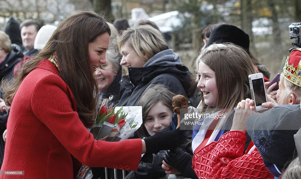 Catherine, Countess of Strathearn is shown a doll by Dayna Miller which she got as a Christmas present as she stops to talk to some school children during a visit to Dumfries House on March 05, 2013 in Ayrshire, Scotland. The Duke and Duchess of Cambridge braved the bitter cold to attend the opening of an outdoor centre in Scotland today. The couple joined the Prince of Wales at Dumfries House in Ayrshire where Charles has led a regeneration project since 2007. Hundreds of locals and 600 members of youth groups including the Girl Guides and Scouts turned out for the official opening of the Tamar Manoukin Outdoor Centre.