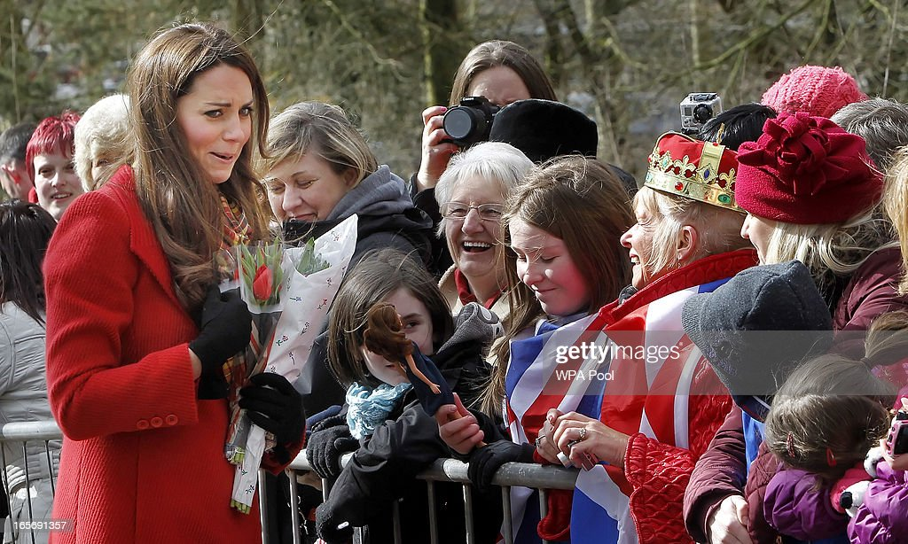 <a gi-track='captionPersonalityLinkClicked' href=/galleries/search?phrase=Catherine+-+Duchess+of+Cambridge&family=editorial&specificpeople=542588 ng-click='$event.stopPropagation()'>Catherine</a>, Countess of Strathearn is shown a doll of herself by Dayna Miller which she got as a Christmas present as she stops to talk to some school children during a visit to Dumfries House on March 05, 2013 in Ayrshire, Scotland. The Duke and Duchess of Cambridge braved the bitter cold to attend the opening of an outdoor centre in Scotland today. The couple joined the Prince of Wales at Dumfries House in Ayrshire where Charles has led a regeneration project since 2007. Hundreds of locals and 600 members of youth groups including the Girl Guides and Scouts turned out for the official opening of the Tamar Manoukin Outdoor Centre.