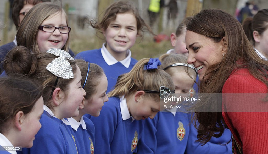 Catherine, Countess of Strathearn stops to talk to some school children during a visit to Dumfries House on March 05, 2013 in Ayrshire, Scotland. The Duke and Duchess of Cambridge braved the bitter cold to attend the opening of an outdoor centre in Scotland today. The couple joined the Prince of Wales at Dumfries House in Ayrshire where Charles has led a regeneration project since 2007. Hundreds of locals and 600 members of youth groups including the Girl Guides and Scouts turned out for the official opening of the Tamar Manoukin Outdoor Centre.