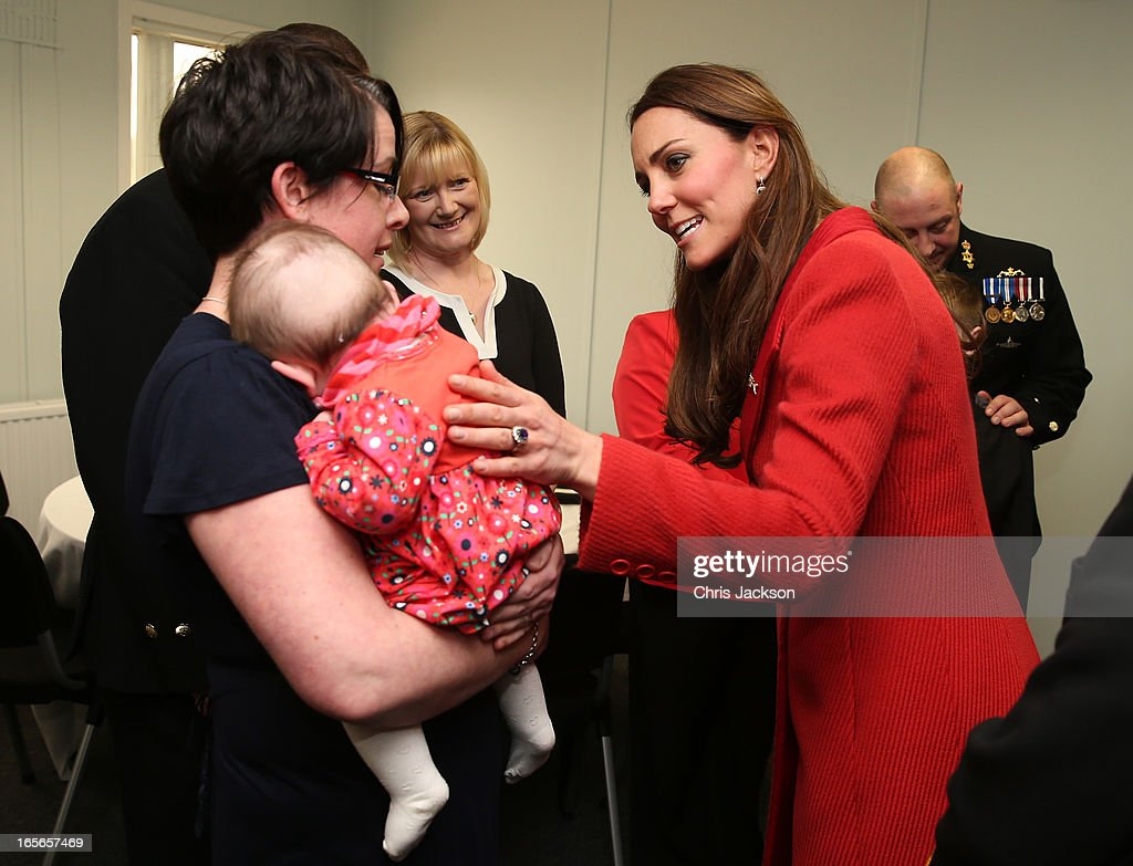 <a gi-track='captionPersonalityLinkClicked' href=/galleries/search?phrase=Catherine+-+Duchess+of+Cambridge&family=editorial&specificpeople=542588 ng-click='$event.stopPropagation()'>Catherine</a>, Countess of Strathearn talks to members of the crew and their families as she visits the Astute-class Submarine Building at BAE Systems on April 5, 2013 in Barrow-in-Furness, United Kingdom. The Duke of Cambridge is Commodore-in-Chief of the Royal Navy Submarine Service and during their visit they will tour the offices of Vanguard replacement programme and meet with the crew of Artful and their families, who are now based in Barrow.