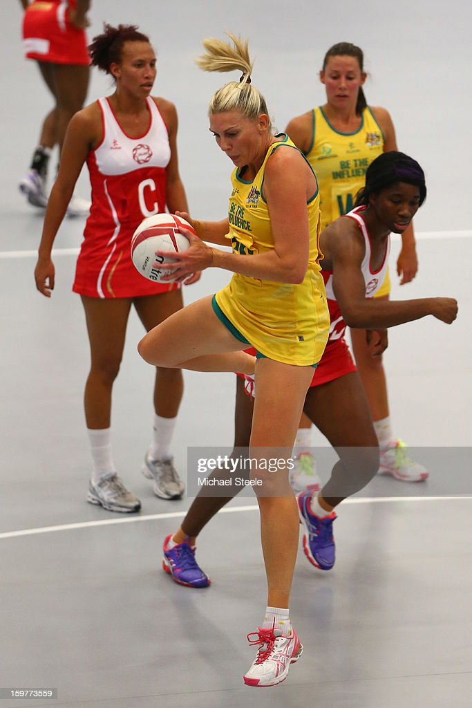 Catherine Cox of Australia gathers the ball during the England v Australia International Netball Series match at the University of Bath on January 20, 2013 in Bath, England.