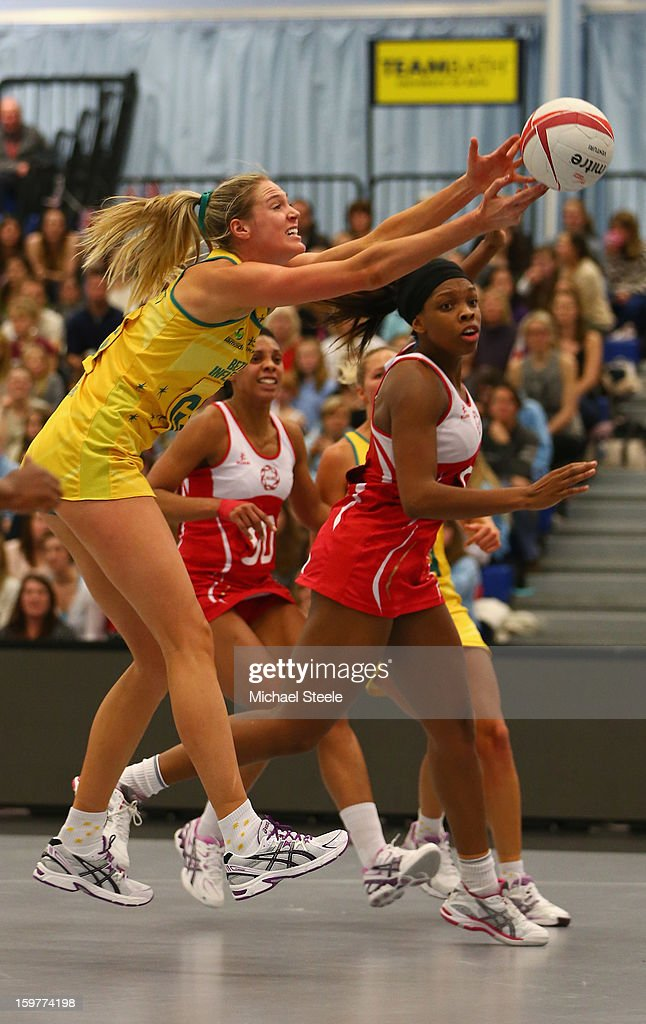 Catherine Cox (L) of Australia stretches for the ball during the England v Australia International Netball Series match at the University of Bath on January 20, 2013 in Bath, England.