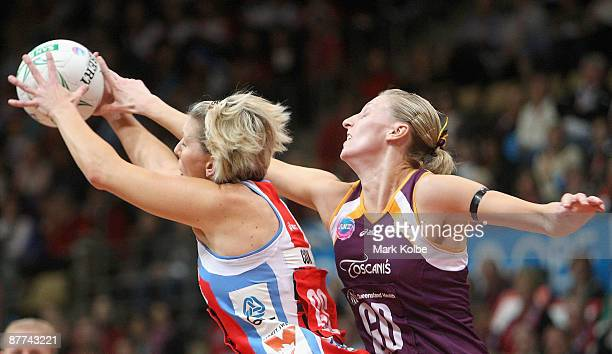 Catherine Cox of the Swifts and Peta Stephens of the Firebirds compete for the ball during the round seven ANZ Championships match between the Sydney...