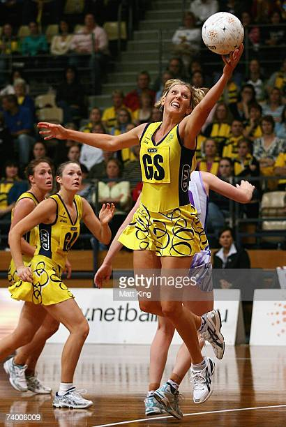 Catherine Cox of the Swifts jumps for the ball during the round one 2007 Commonwealth Bank Trophy match between the Sydney Swifts and the Adelaide...