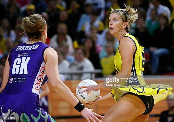 Catherine Cox of the Swifts looks to pass during the Commonwealth Bank Trophy Final match between the Melbourne Phoenix and the Sydney Swifts at Acer...