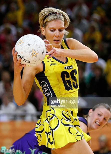 Catherine Cox of the Swifts takes a pass during the Commonwealth Bank Trophy Final match between the Melbourne Phoenix and the Sydney Swifts at Acer...