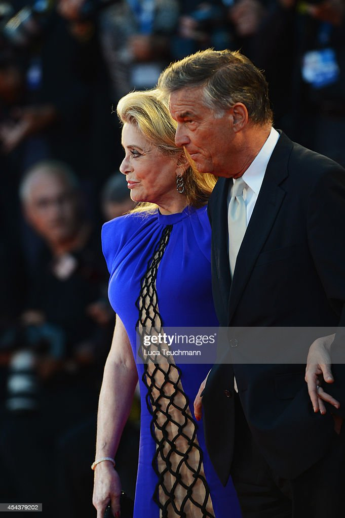 Catherine Deneuve and Benoit Jacquot attend the '3 Coeurs' premiere during the 71st Venice Film Festival on August 30, 2014 in Venice, Italy.