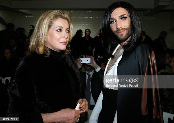 Catherine Deneuve and Conchita Wurst attend the Jean Paul Gaultier show as part of Paris Fashion Week Haute Couture Spring/Summer 2015 on January 28...