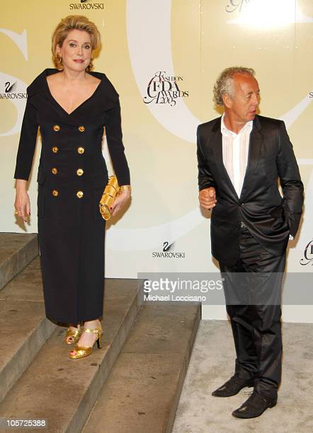 Catherine Deneuve and Gilles Bensimon during 2005 CFDA Fashion Awards Arrivals at The New York Public Library in New York City New York United States