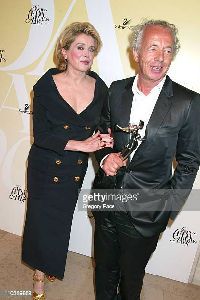 Catherine Deneuve and Gilles Bensimon during 2005 CFDA Fashion Awards Inside the Dinner Green Room Departures at New York Public Library in New York...