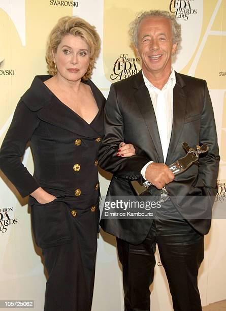 Catherine Deneuve and Gilles Bensimon publication director of ELLE Magazine and recipient Eugenia Sheppard Award