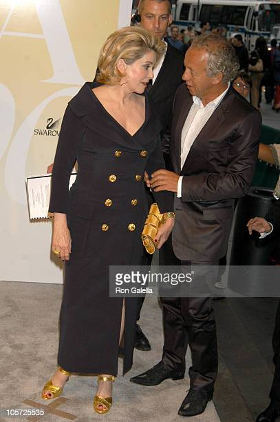 Catherine Deneuve and Gilles Bensimon publication director of ELLE Magazine and recipient Eugenia Sheppard Award