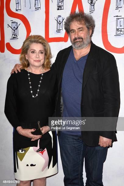 Catherine Deneuve and Gustave Kervern attend 'Dans La Cour' Paris Premiere at Mk2 Bibliotheque on April 15 2014 in Paris France