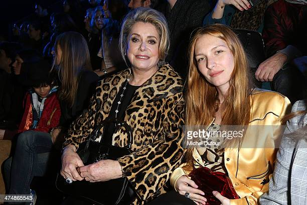 Catherine Deneuve and Josephine de la Baume attend the ETAM show as part of the Paris Fashion Week Womenswear Fall/Winter 20142015 on February 25...