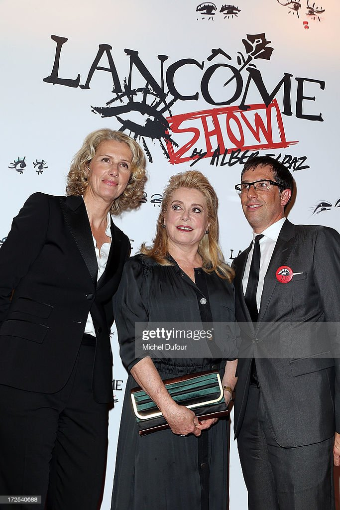 Catherine Deneuve and Nicolas Hieronimus attend the 'Lancome Show by Alber Elbaz' at Le Trianon on July 2, 2013 in Paris, France.