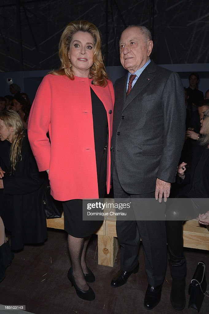 <a gi-track='captionPersonalityLinkClicked' href=/galleries/search?phrase=Catherine+Deneuve&family=editorial&specificpeople=123833 ng-click='$event.stopPropagation()'>Catherine Deneuve</a> and Pierre Berge attend the Saint Laurent Fall/Winter 2013 Ready-to-Wear show as part of Paris Fashion Week on March 4, 2013 in Paris, France.