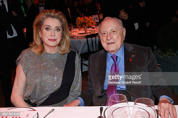 Catherine Deneuve and Pierre Berge attend the Sidaction Gala Dinner 2017 Haute Couture Spring Summer 2017 show as part of Paris Fashion Week on...