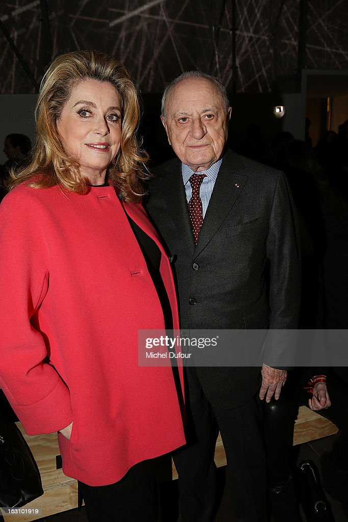 <a gi-track='captionPersonalityLinkClicked' href=/galleries/search?phrase=Catherine+Deneuve&family=editorial&specificpeople=123833 ng-click='$event.stopPropagation()'>Catherine Deneuve</a> and Pierre Berger attend the Saint Laurent Fall/Winter 2013 Ready-to-Wear show as part of Paris Fashion Week on March 4, 2013 in Paris, France.