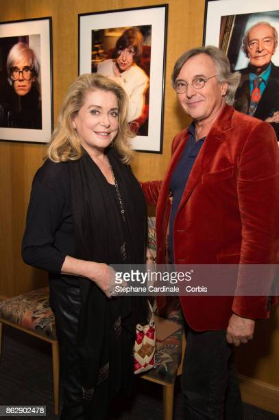 Catherine Deneuve and Pierre Passebon attend the Simon Bocanegra and Philippe Morillon Exhibition at la Galerie Du passage Pierre Passebon on October...